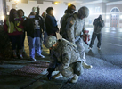 Missouri National Guard soldiers Sgt. First Class Eric Allison (left) and Major Lance Dell collect pieces of an American flag protesters burned and tossed to the ground outside the Ferguson police department Thursday, Dec. 4. 2014.  {quote}They're treating it as trash, it's not trash to us.  We're not going to let them throw it on the ground and leave it there{quote} said Dell. Photo By David Carson, dcarson@post-dispatch.com