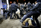 Police and protesters get into a physical fight on Wednesday, Dec. 24, 2014 on the lot of gas station where a teenager was fatally shot by a police officer late Tuesday Dec. 23, 2014 at a Mobil gas station on North Hanley Road in Berkeley. Photo By David Carson, dcarson@post-dispatch.com