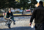 A man carrying a baby stroller across a set of train tracks in Hyattsville, Md., is stopped by CXS railroad police on Thursday, Nov. 29, 2012.  Even though the officer was only in the area performing surveillance of the tracks on an unrelated investigation he said he feels compelled to stop people who are trespassing when he sees it.  The man with the stroller, who did not want to be identified, was given a warning by the police.  Two fatalities have occurred in the area where the man crossed the tracks.  There are several no trespassing signs posted along either side of the tracks.Photo By David Carson, dcarson@post-dispatch.com