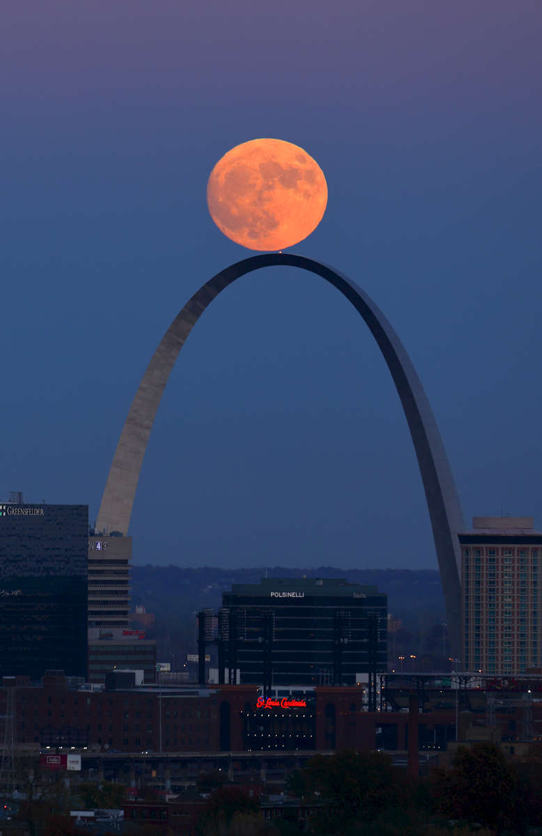 The supermoon rises over the Arch in St. Louis as seen from the Compton Hill Water Tower on Sunday, Nov. 13, 2016. The supermoon will peak on early Monday morning shortly before sunrise, it will be the nearest supermoon in almost 70 years and will be the largest  until Nov. 25, 2034. A supermoon happens when a full moon makes its closest pass to Earth appearing up to 14 percent bigger and 30 percent brighter in the sky. Viewing of the moon should also be good on Monday after the sun sets and the moon rises out of the east. Photo by David Carson, dcarson@post-dispatch.com
