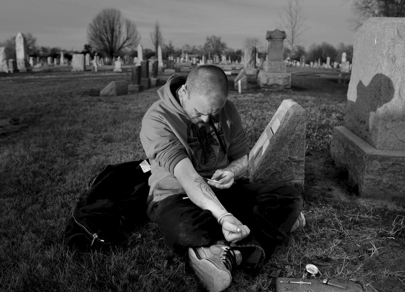 Richard Skinner shoots a mix of heroin and meth called a speedball in a quiet spot of cemetery in south St. Louis on Thursday, Feb. 16, 2017. {quote}Death ain't nothing to me anymore{quote} says Skinner who had to be revived by paramedics from a a near fatal overdose just a few weeks ago. Photo by David Carson, dcarson@post-dispatch.com