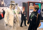 Mathew Hebert (left), from Midnight Studios out of Mesa, Arizona, stops to talk with Janice Smith, from Ballwin, as he walks the floor of the 17th annual Halloween and Attractions Show at America's Center in St. Louis.