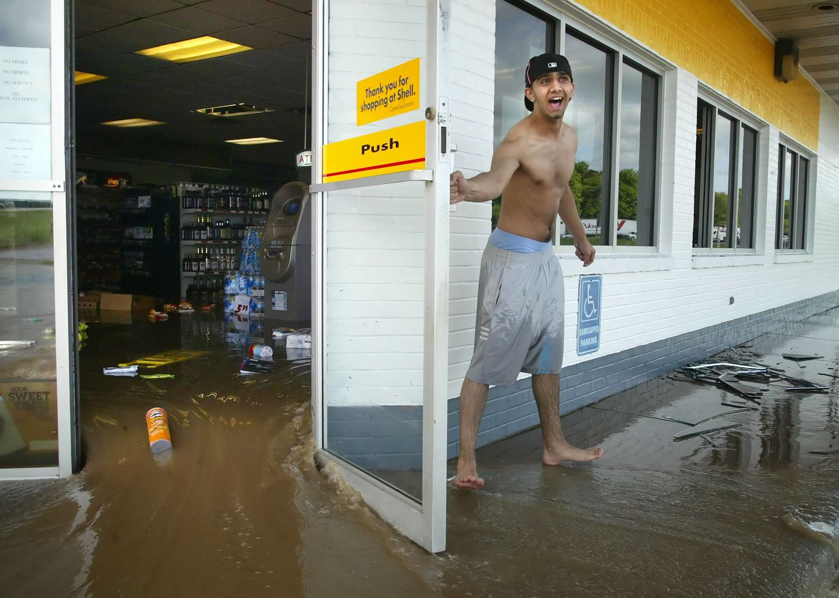 Friday May 8, 2009--Gary Chhina(cq) opens the door to his family's Shell gas station after flash flood waters rushed filled the store with about 2 feet of water near the intersection of Interstate 55 and State Highway Y in Bloomsdale on Friday afternoon.  Heavy rains swelled Establishment Creek and it rapidly rose forcing police to close Interstate 55 in both directions at one point.David Carson  •  dcarson@post-dispatch.com