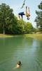 Monday August 5, 2002--Jake Whitehead, 16, of Edwardsville, launches himself off a rope swing into a pond as his friend Shaun Fink, 16, of Glen Carbon watches.  {quote}We're just hanging out, cooling off and having fun{quote} said Fink of their mid-afternoon dip in a swimming hole off of  Oaklawn Road in Glen Carbon on Monday.  Tempature will cool off into the upper 80's for Tuesday but return to the mid-90's later in the week.Photo By David Carson/PD