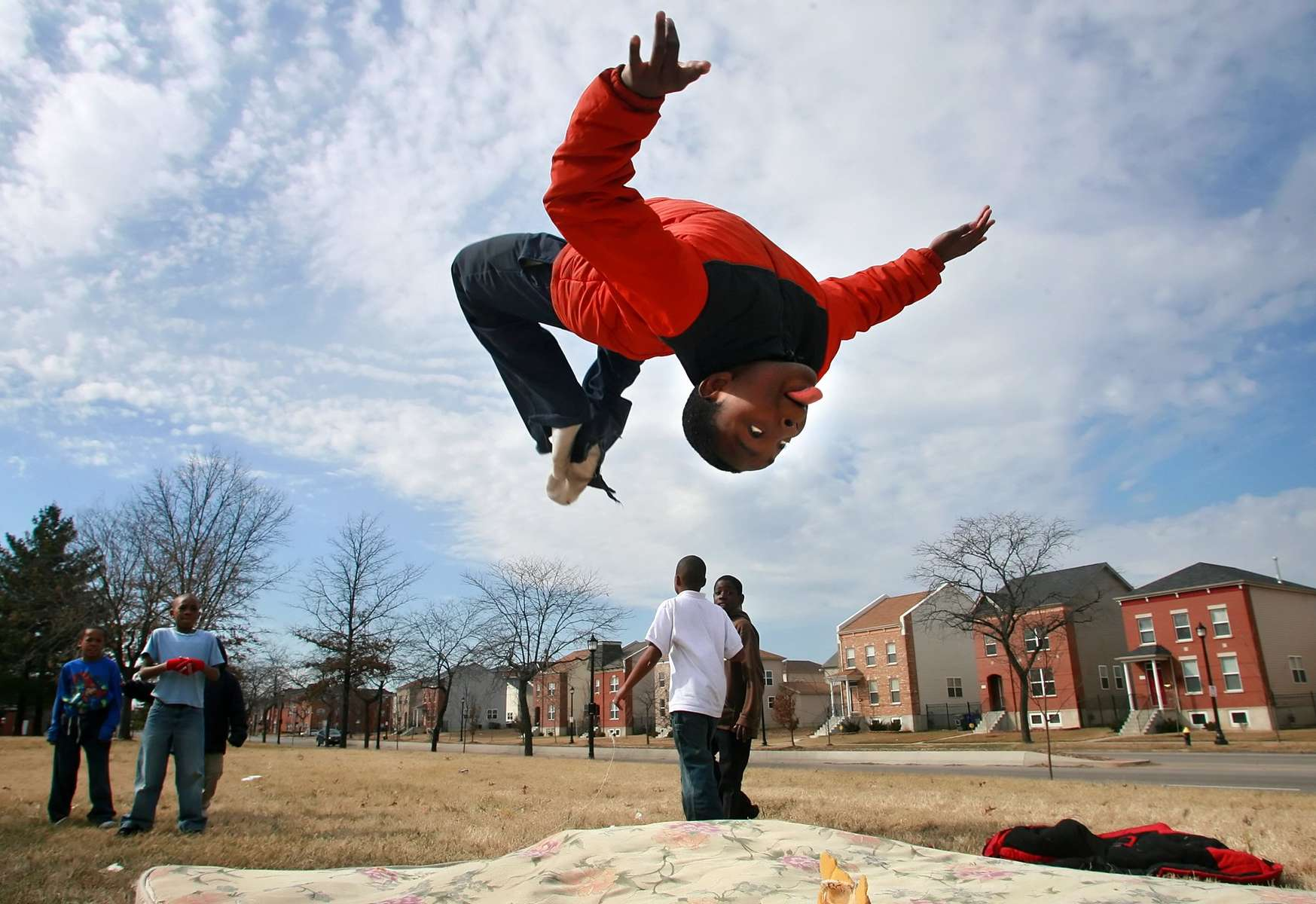 Dwight Jones, 13, tumbles over an old mattress he and his friends were playing with in south St. Louis. Jones says he likes the energy of tumbling and learned his skills from his brother and lots of practice.David Carson | Post-Dispatch