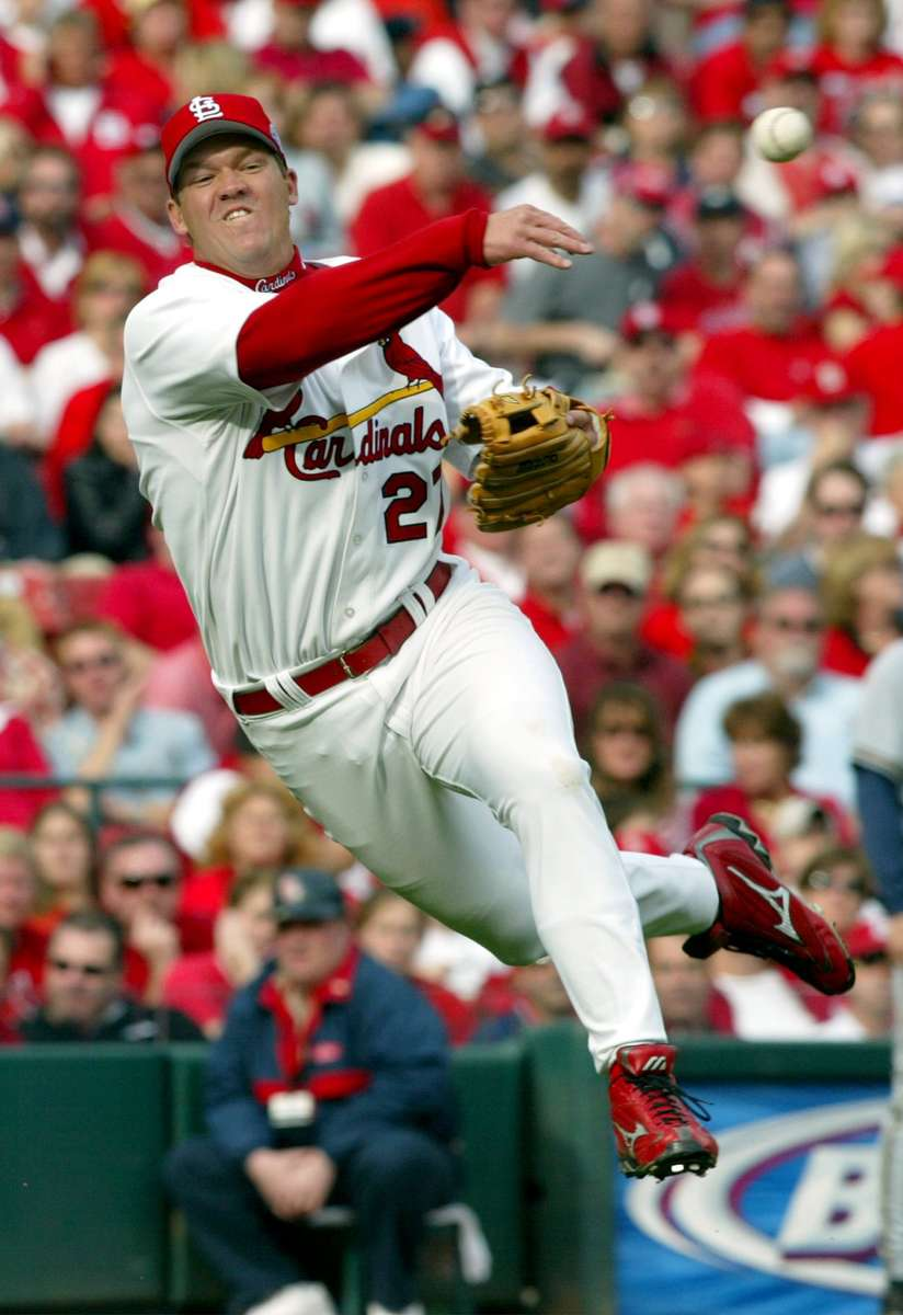 Cards third basmen Scott Rolen attempts to throw out Milwaukee's Chad Moeller in the XXX inning at Busch Stadium on Monday April 5, 2004.(David Carson/St. Louis Post-Dispatch)