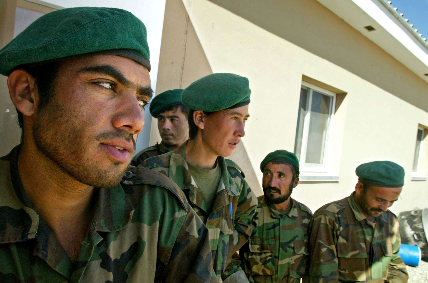 Afghanistan Five Years Later-Afghan National Army--Members of the Afghan National Army gather outside their barracks in Kandahar. Training the Afghan Army to stand on its own is a priority for United States but desertion and retention plague the Afghan Army.