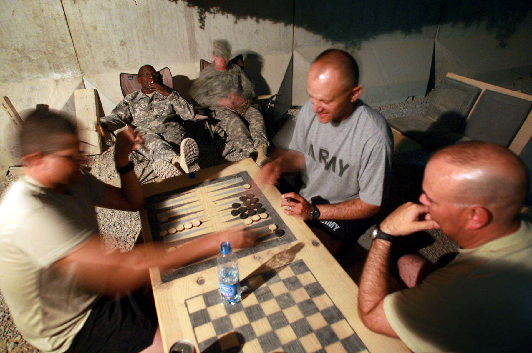 Afghanistan Five Years Later-Down Time-Members of the Missouri National Guard relax during some down time from their mission of training of the Afghan National Army in Kandahar.  The Americans fight side by side with Afghans but sleep and live on their own base seperate from the Afghans.