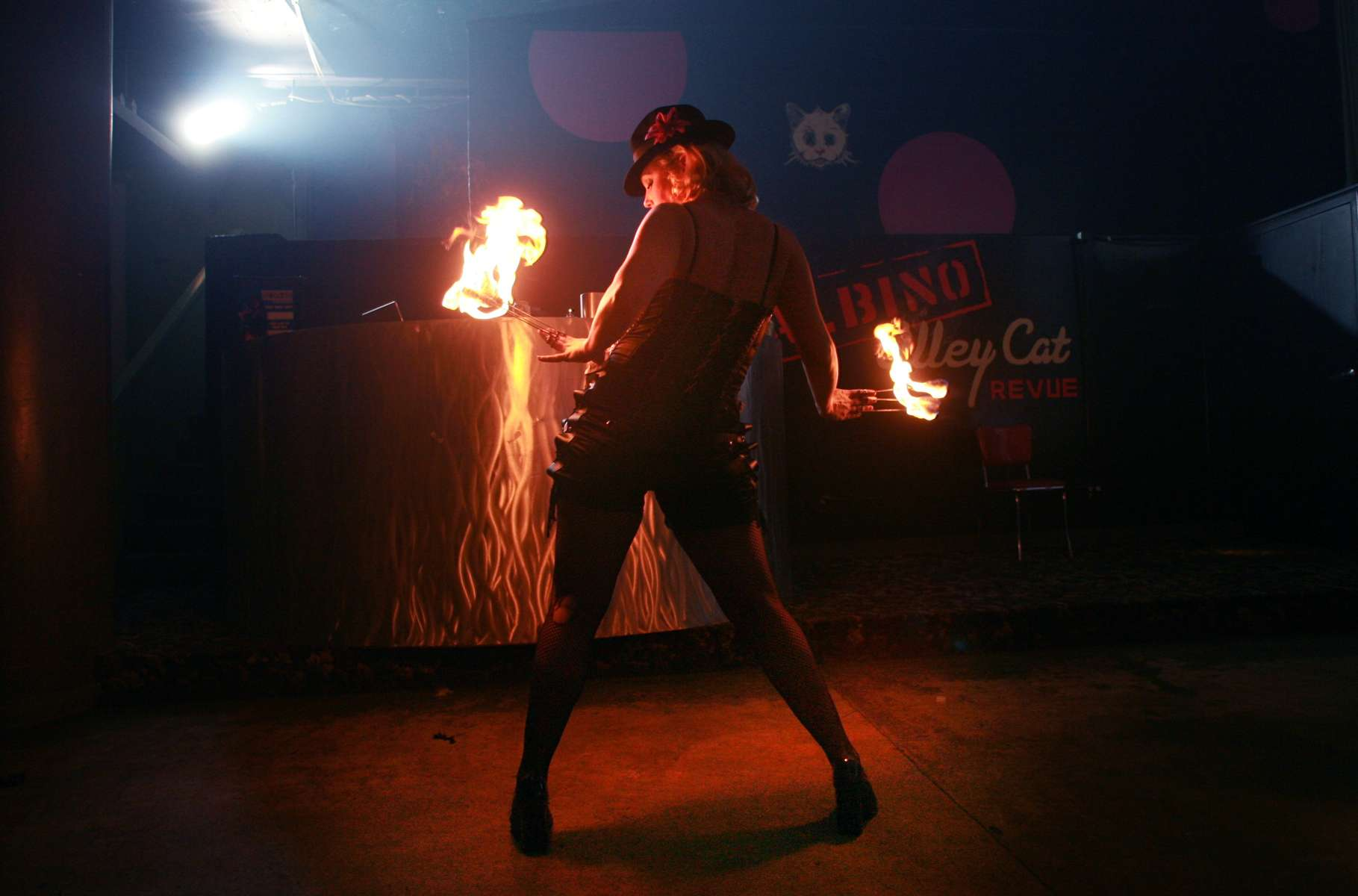 Sturdy Gurlesque performs one of her burlesque routines that feature fire as part of the Albino Alley Cat Revue on stage at Rue 13 on Washington Ave in St. Louis.