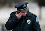 Wednesday February 4, 2004--St. Louis Police officer XXXXXX Fischer wipes tears from her eyes after fellow officer Nicholas Sloan was laid to rest at Calvary Cemetery on Wednesday.Photo By David Carson/PD  (We are working on Getting officer Fischer's first name at this time)