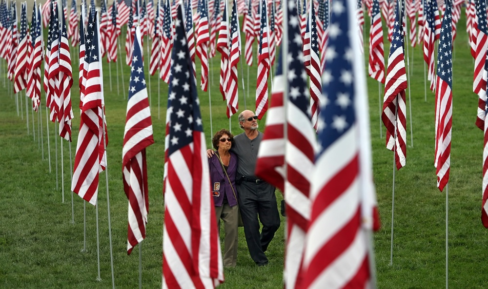 Click here to watch video-- Two hundred and sixty volunteers swarmed Art Hill on Saturday morning staking 2996 flags into the ground.  On Sunday three different memorial services at the site will mark the 10th anniversary of 9/11 terrorist attacks.