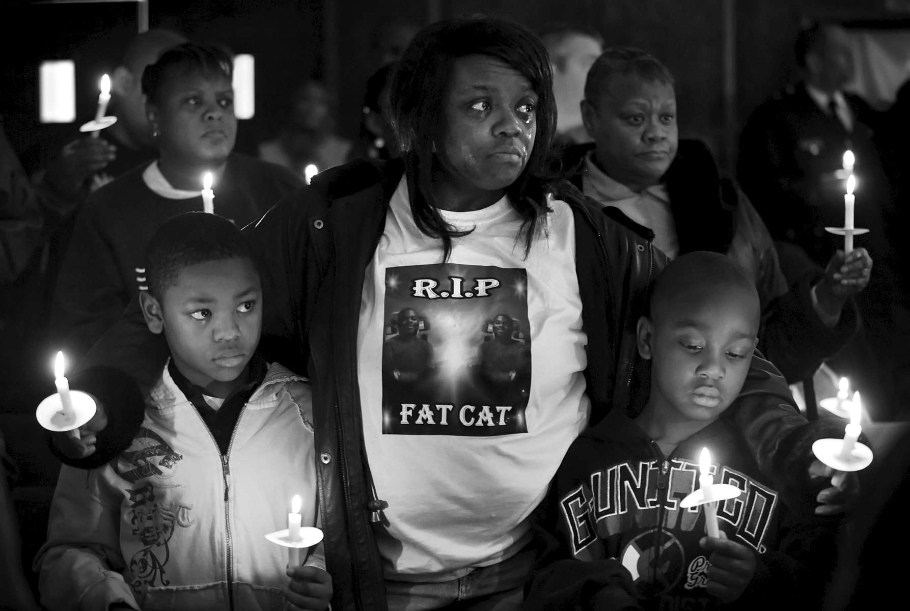 Thursday December 31, 2009--Byron Blassingame Jr., left, and Darrion Bassingame Jr., right, are comforted by their grandmother Jacqueline Heard, center, as the names of the 145 murder victims from the city of St. Louis are read aloud during the 18th Annual Families Advocating Safe Streets candle light service to remember 2009's murder victims at El Bethel Church of God in Christ on Thursday in St. Louis.  Heard's son Byron Blassingame Sr. was shot and killed along with two other men in the same SUV as they were waiting at stop light near Union Station on May 8, 2009.  Byron Jr. was Byron Blassingame Sr.'s son and Darrion Blassingame Jr. was his nephew.David Carson     dcarson@post-dispatch.com