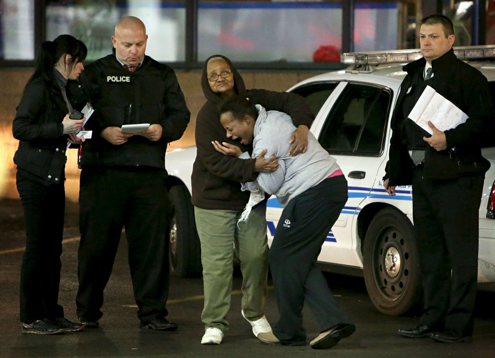 Toni Martin (center) cries out on Wednesday, Dec. 24, 2014 as she talks to police at the scene were her son Antonio Martin, 18, was fatally shot Tuesday Dec. 23, 2014 at a Mobil gas station on North Hanley Road in Berkeley. Photo By David Carson, dcarson@post-dispatch.com