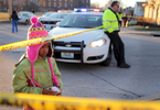 Destiny Mims, 6, watches as police work the scene of a fatal shooting on North 8th Street in St. Louis on Wednesday, Jan. 13, 2016. Mims ,who lives a block away from where the shooting happened, was walking home from school with her mother and brother when they stopped to view the scene. As police were investigating the shooting on North 8th Street more gun shots were heard in the distance, to the east near Interstate 70.Photo by David Carson, dcarson@post-dispatch.com