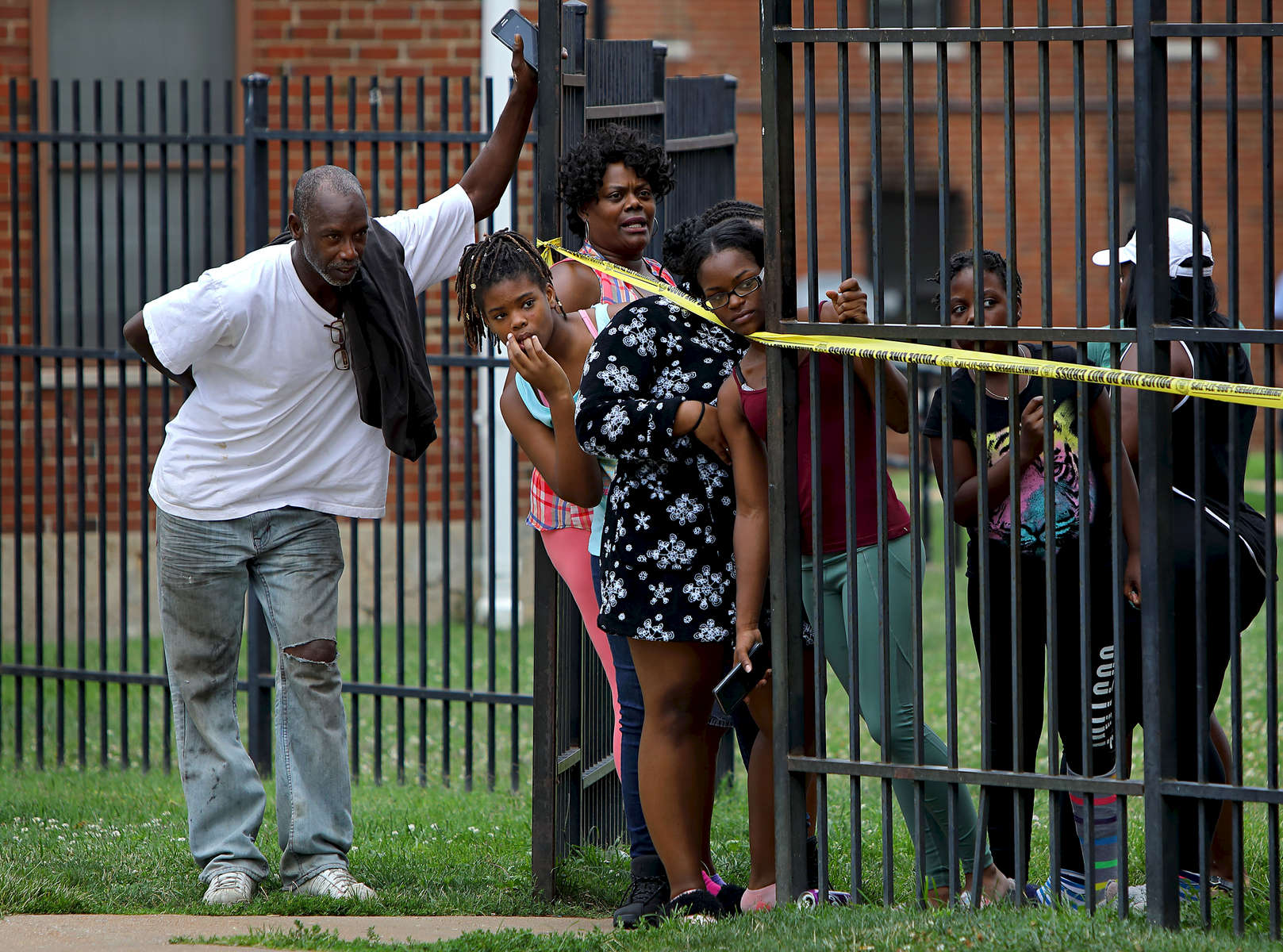 Residents watch as police investigate the scene of a fatal shooting in the 1400 block of Kealty Lane in St. Louis on Monday, Aug. 7, 2017. The suspect in the shooting returned to the shooting scene driving a minivan and surrendered to police.Photo by David Carson, dcarson@post-dispatch.com