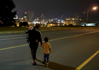 Donna Green and her sons Chris Allen (right), 3, and Donovan Allen, 2, crosses Chouteau Avenue shortly before 5 a.m. in the morning as they head to the bus stop on Monday, Aug. 14, 2017. Green works at a McDonalds in north St. Louis County and needs to leave her home in St. Louis City before 5 a.m. to catch two buses to drop her children at daycare. She then takes another bus to work.Photo by David Carson, dcarson@post-dispatch.com