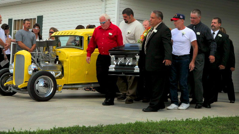 Click here to watch video--Hundreds of friends and family members of Jeffrey {quote}Smitty{quote} Smith showed up at his funeral in their hot rods and muscle cars. The mourners stopped in front of his business, where he was murdered, on their way to the cemetery to do burnouts in honor of Smith .