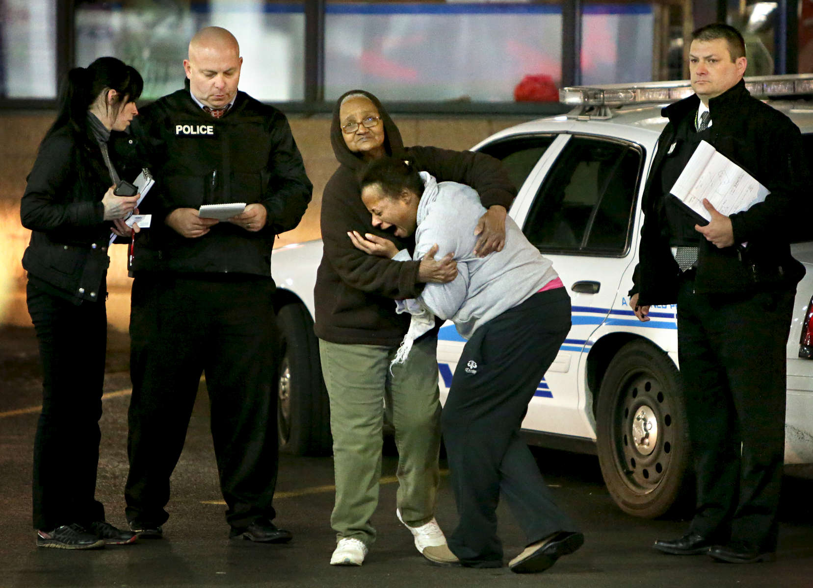 Toni Martin (center) cries out on Wednesday, Dec. 24, 2014 as she talks to police at the scene where her son Antonio Martin, 18, was fatally shot Tuesday Dec. 23, 2014 at a Mobil gas station on North Hanley Road in Berkeley. Photo By David Carson, dcarson@post-dispatch.com