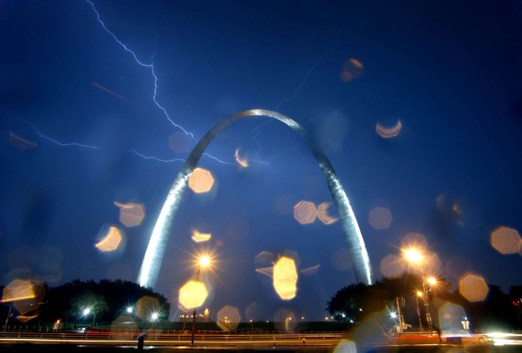 Lightning streaks across the sky above the Gateway Memorial Arch in downtown St. Louis on Saturday.