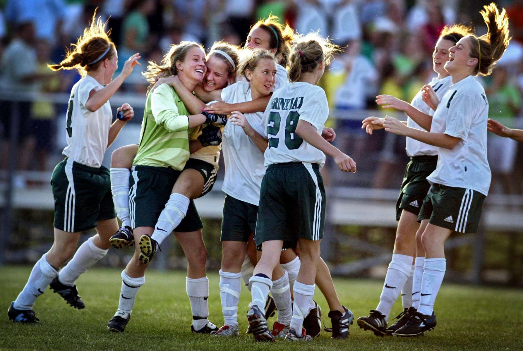 Nerinx Hall girls soccer team members celebrate their overtime penalty kick shootout win over Cor Jesu in St. Louis County, Mo. on Thursday May 19, 2005.