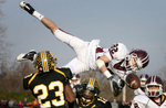 Saturday November 20, 2010--De Smet's Jack Barry is up ended as he tries to recover an on side kick over Hazelwood Central's Mike Jordan, left, and Sean Wills, center, at Hazelwood Central on Saturday. Hazelwood Central defeated De Smet 20-14 to advance to the state championship.David Carson     dcarson@post-dispatch.com