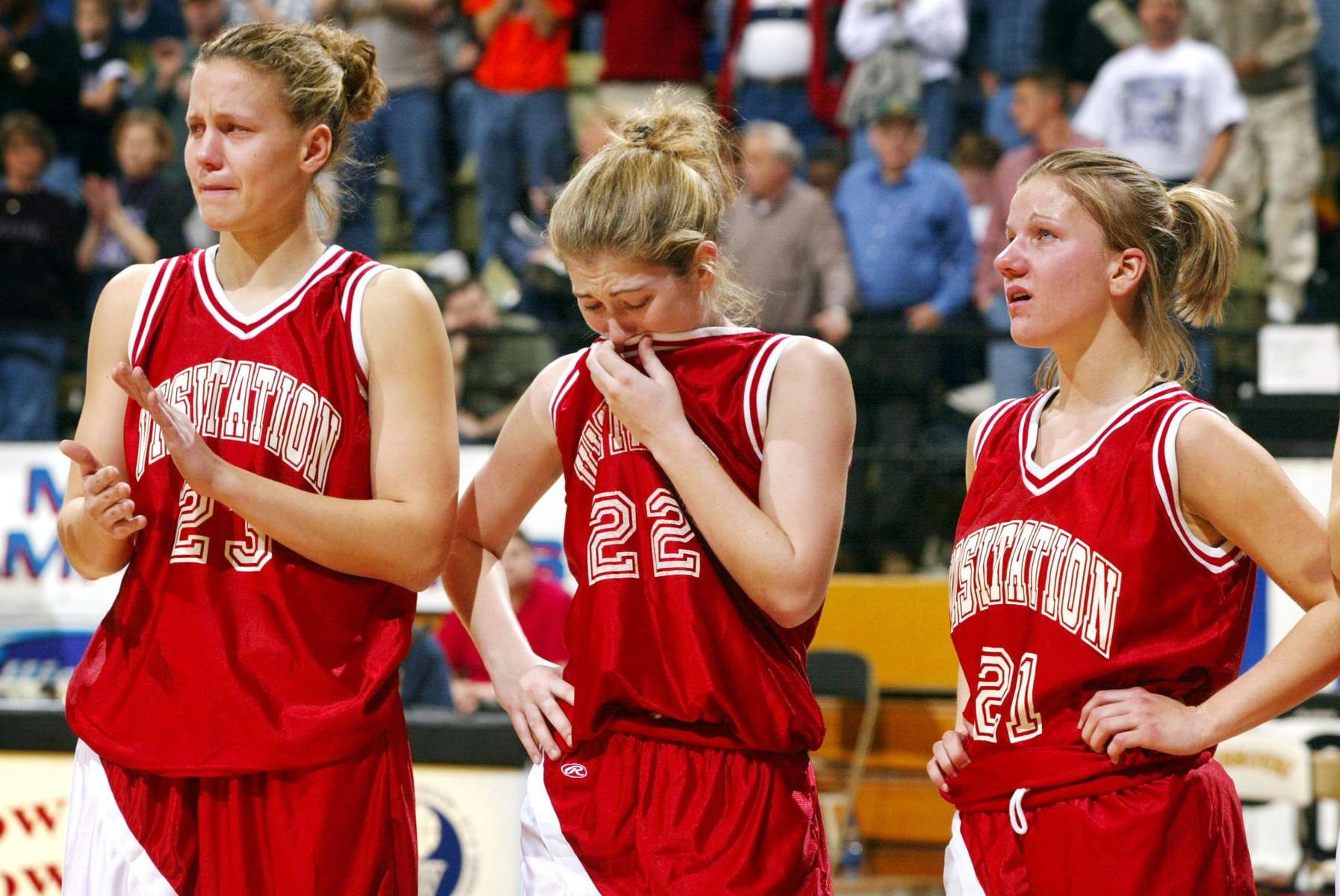 Saturday March 9, 2002--Visitation's Stephanie Anderson, left, Jenny Maurer, center, and Liz Stamborski wait to recieve their runners up medals  after losing to Notre Dame de Sion 63-46 in the Missouri State High School Activities Association Basketball Championships Class 3a Championship game in Columbia on Saturday.Photo By David Carson/PD