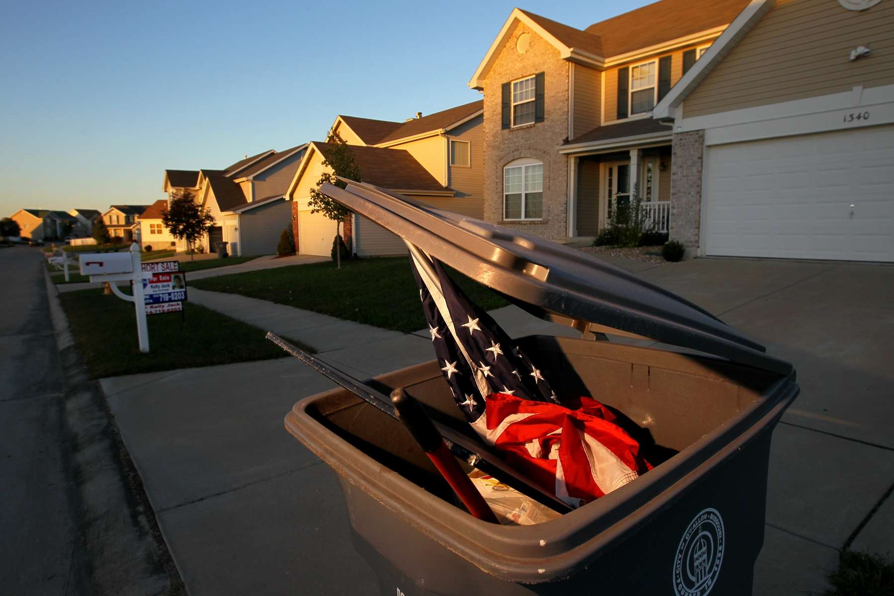 Thursday October 7, 2010--An American flag is put out with the trash from a home being put on the market as a short sale in the Briarchase subdivision in O'Fallon.  The subdivision has had 17 foreclosures since the recession began.David Carson     dcarson@post-dispatch.com