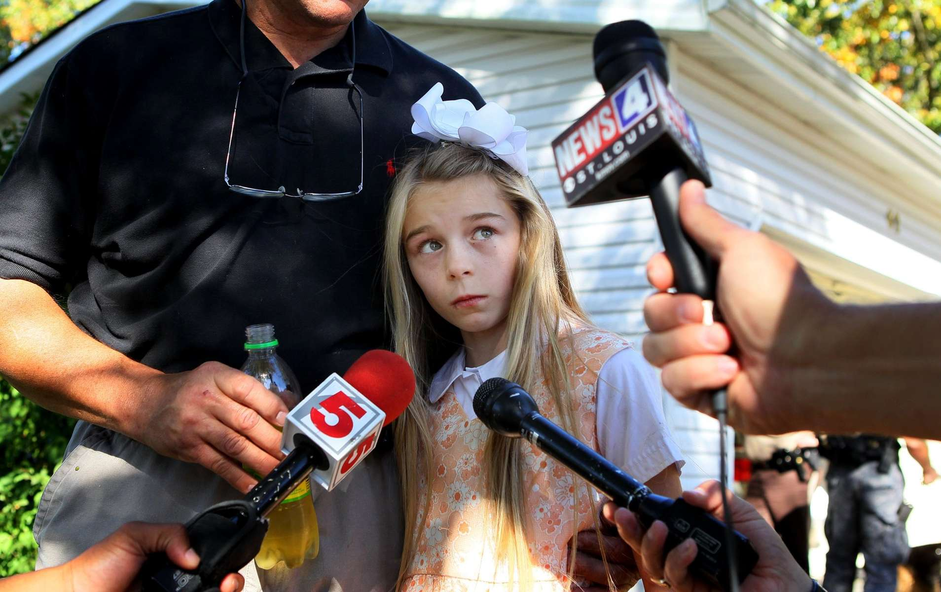 Friday October 8, 2010--Rachel Wilkerson, 10, talks to the media in the front yard of her home in Troy, Missouri after she showed up back home on her own.  Rachel had been missing for more than six hours and a search was underway for the child when she walked out of the woods next to her home.  The girl said she had taken a nap in the woods.David Carson     dcarson@post-dispatch.com