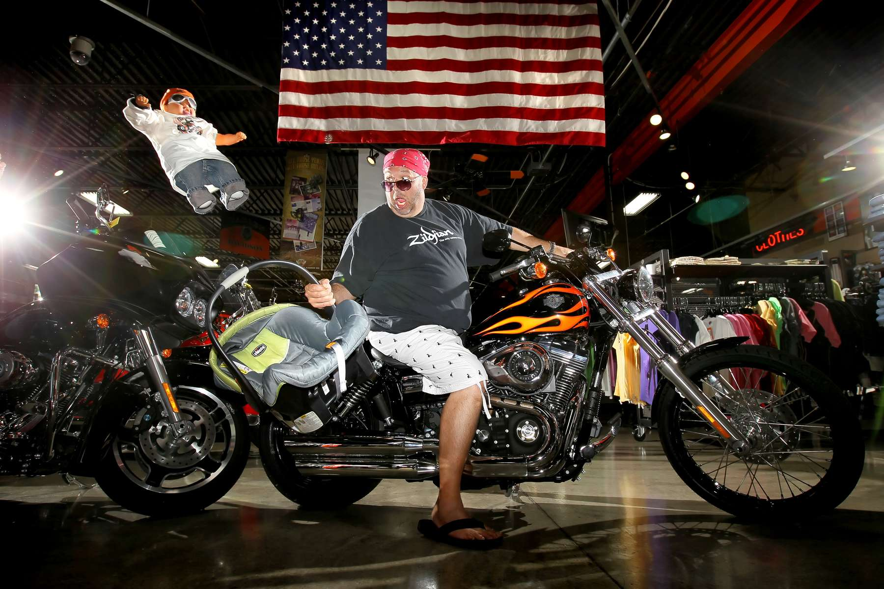 Friday July 16, 2010--KMOX radio personality John Carney doesn't own a motorcycle but he lusts for a Harley-Davidson.  The father of four, including two young children, doesn't believe a Harley could accomodate a child seat.  For this picture Carney climbed on a 2010 Dyna Wide Glide at Doc's Harley-Davidson in Kirkwood.David Carson     dcarson@post-dispatch.com