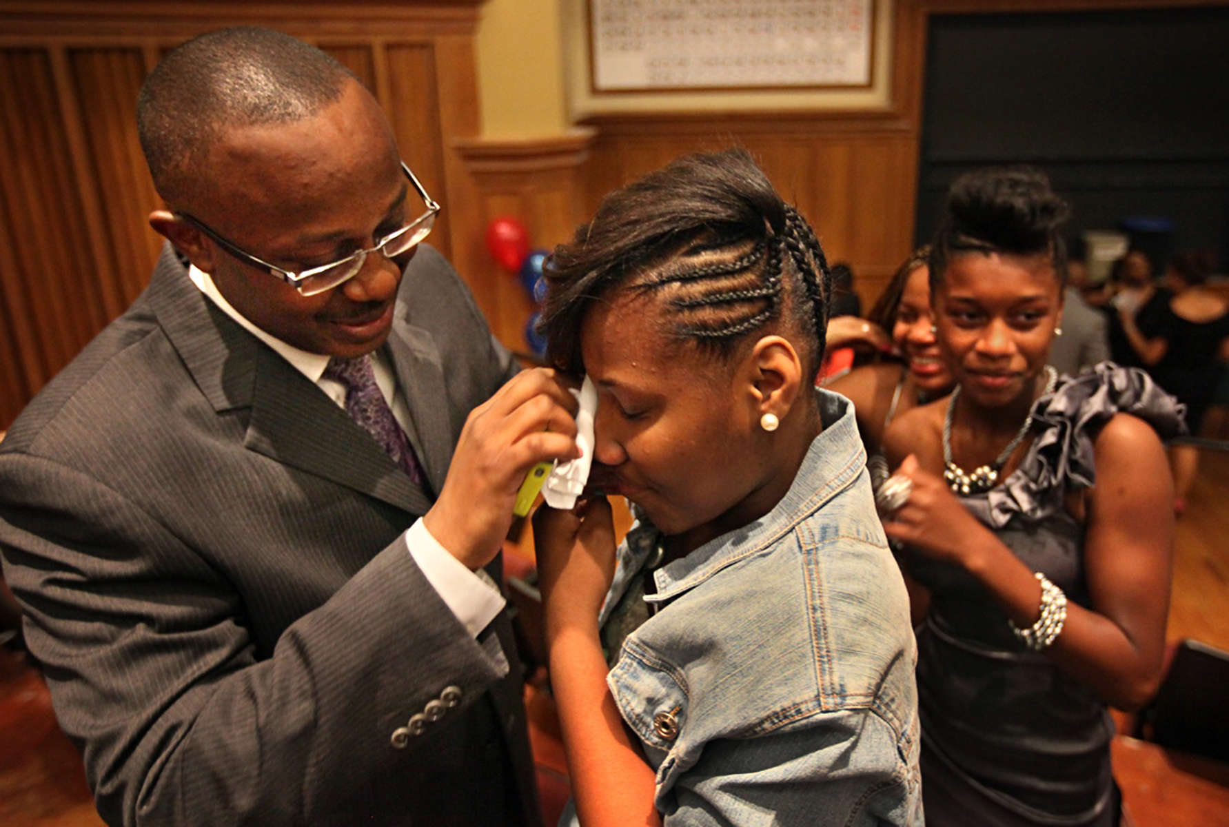 KIPP: Inspire Academy science teacher John Armstead (left) wipes tears from the eyes of Brittany King after King stopped to thank him for teaching her at the end of the promotion ceremony at Washington University on Friday, May 24, 2013.  Photo By David Carson, dcarson@post-dispatch.com