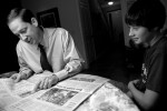 State Rep. Joe Negron scans the sports pages and talks about football with his son Jonathan, 15, at the breakfast table around 7 a.m. at their home before taking him to school and starting a full day of campaigning for Florida's 16th Congressional District seat.