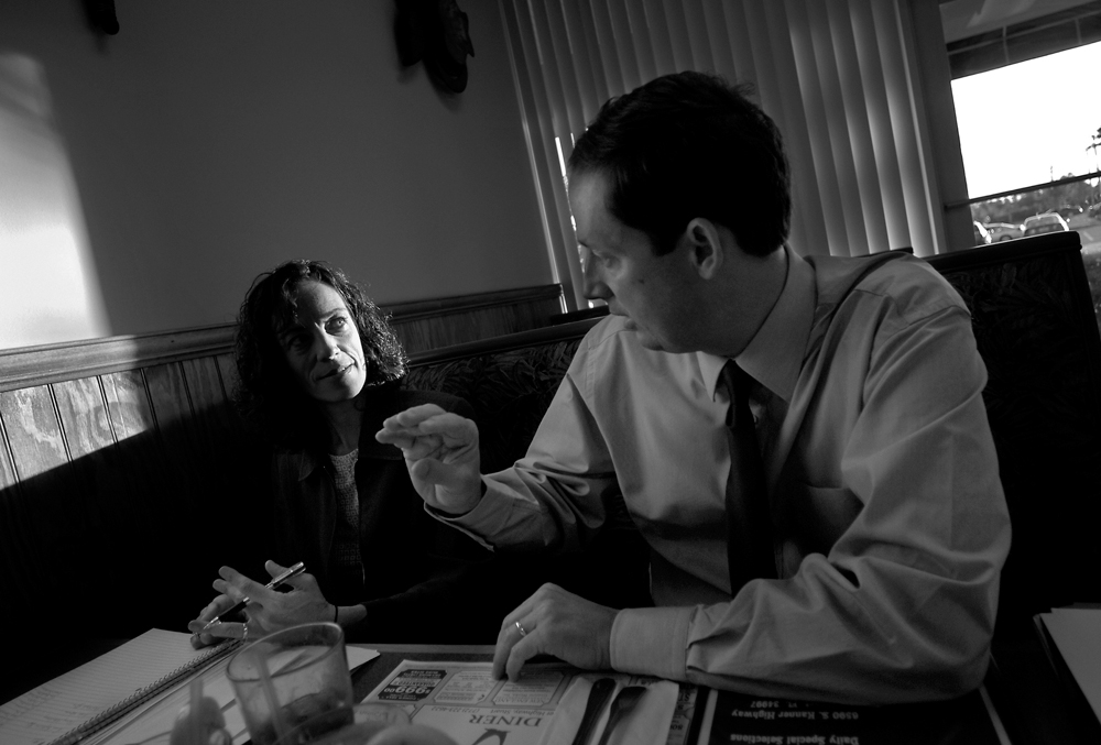 Negron goes over the day's schedule with campaign coordinator Cheri Vancura at the Galaxy Diner in Stuart, Fla. The days start early and end late for Negron as he seeks the congressional seat.