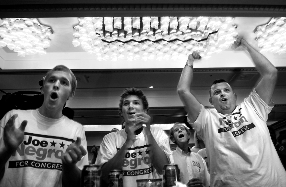 At Negron's election party at the Hutchinson Island Marriott Beach Resort and Marina in Stuart, Fla., Eric Going, 17, left, Darrell Pittman, 16, and James Collins, all of Hobe Sound, Fla., cheer as Negron takes a one percent lead over Democratic challenger Tim Mahoney.