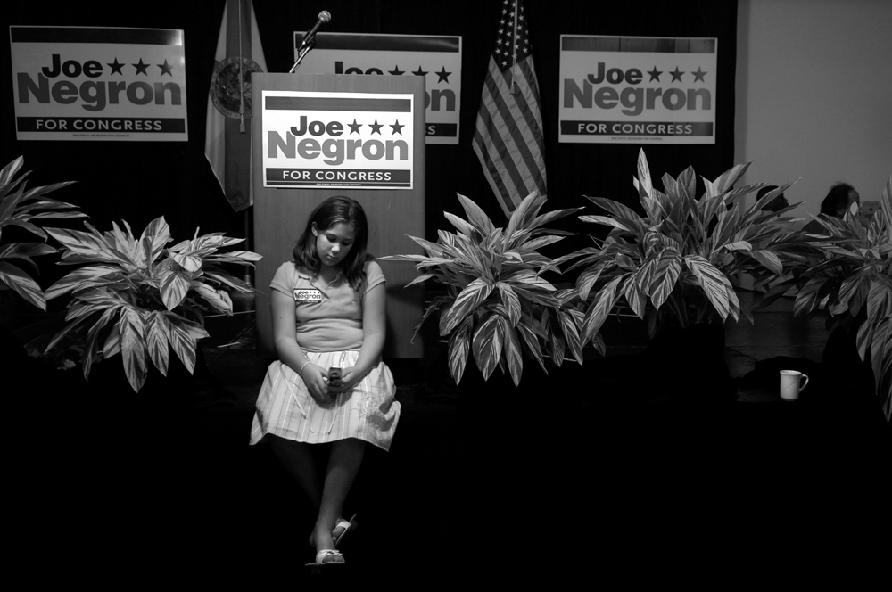 Heather Carroll, 10, of Hobe Sound, Fla., passes the time at congressioanl candidate Joe Negron's election party on Hutchinson Island. Supporters waited several hours before Negron made his way into the ball room where he anounced to the large crowd that he conceded to Democratic challenger Tim Mahoney.