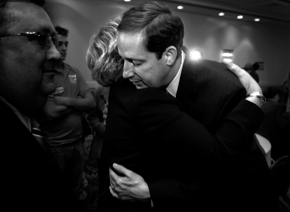 Negron, right, is hugged by Superintendent of Schools for Martin County, Sara Wilcox, after conceeding to Democratic challenger Tim Mahoney at his election party on Hutchinson Island in Stuart, Fla.