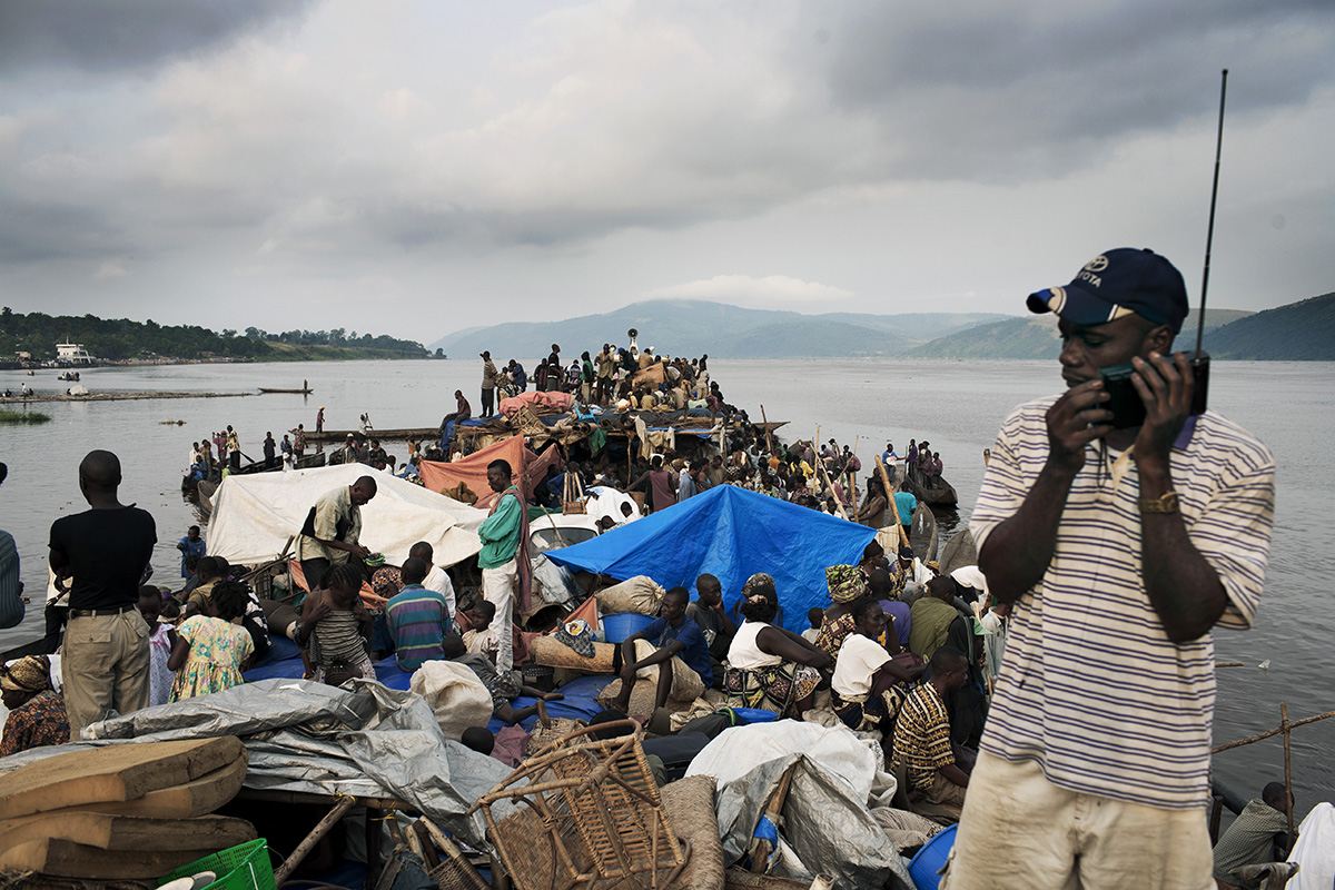 MALUKU, DEMOCRATIC REPUBLIC OF CONGO APRIL 26: Unidentified passengers wait to disembark from a boat after traveling for seven weeks on April 26, 2006 in the port in Maluku, outside Kinshasa, Congo, DRC. About five hundred passengers traveled on the boat from Kisangani to Kinshasa, a distance of 1750 kilometers. These passengers spent seven weeks on a crowded boat with only two toilets and had to sleep among cargo, and share space with live animals such as pigs, goats, crocodiles, birds, lizards, snakes etc, The Congo River is a lifeline for millions of people, who depend on it for transport and trade. During the Mobuto era, big boats run by the state company ONATRA dominated the traffic on the river. These boats had cabins and restaurants etc. All the boats are now private and are mainly barges that transport goods. The crews sell tickets to passengers who travel in very bad conditions. The conditions on the boats often resemble conditions in a refugee camp. Congo is planning to hold general elections by July 2006, the first democratic elections in forty years. (Photo by Per-Anders Pettersson)