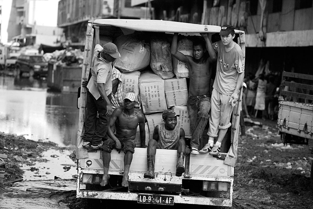 A Chinese businessman travels with a truck full of imported Chinese goods with his Angolan workers, Luanda, Angola, 2007