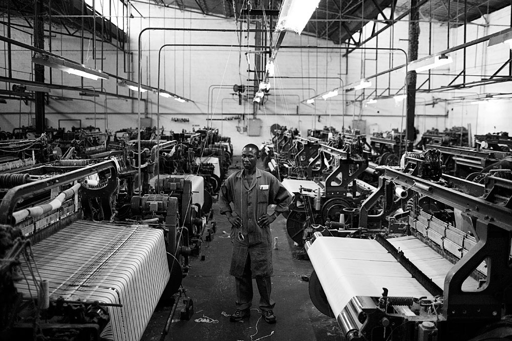 A Zambian worker operates a spinning machine still operating in Makuba Textiles, Ndola, Zambia, 2007. Dune to Chinese imports, most of the textile factories have collapsed in Zambia.