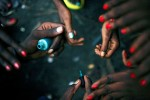 Young child prostitutes paint their nails before working on the street in Matonge, Kinshasa, DRC, 2006