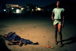 Betty Nginamawu, age 14, a child prostitute, solicits clients while working on the street in Matonge, Kinshasa, DRC, 2006