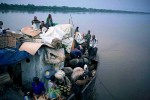 Congolese travel on a barge with about five hundred people, a 5-week long journey of 1000 miles between Kisangani and the capital Kinshasa, Mbandaka, DRC, 2006