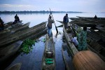 A fisherman departs on his dugout canoe on The Congo River, Lukutu, DRC, 2006