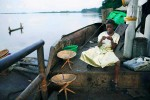 Clarisse Mondo, age 13, an orphan, travels on a barge to look for her lost mother, Lukutu, DRC, 2006