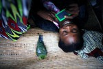 A woman does her makeup on a boat, The Congo River, Mbandka, DRC, 2006