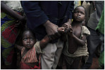 Refugee children wait to be registered after arriving with about 20,000 other refugees in a few days, Dubie, Katanga, 2005