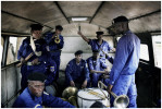 Members of the Congolese National Police Brass band wait to depart after performing at a police graduation ceremony, Kasangulu, DRC, 2006