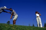 Andile, Mazwai, (c) the first black stockbroker in South Africa and a successful black businessman takes his first golf lesson with his wife, Johannesburg, South Africa, 2002.  He belongs to a new young and educated black elite in the country.