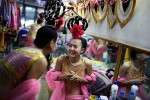 Performers in the Fetian Song and Dance Troupe dress backstage before an evening show in a hotel, DunHuang, China, 2007