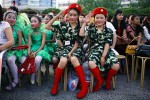 School children wait to perform during a talent competition, Kurle, China, 2007