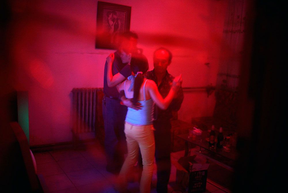 Chinese oil workers dance with prostitutes in a brothel, Tazhong, China, 2007